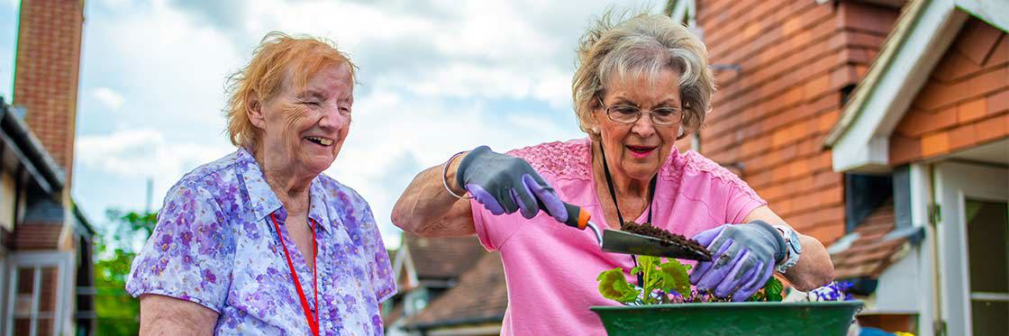 Resident Enjoying Gardening Club at Linfield House Care Home in Worthing, West Sussex