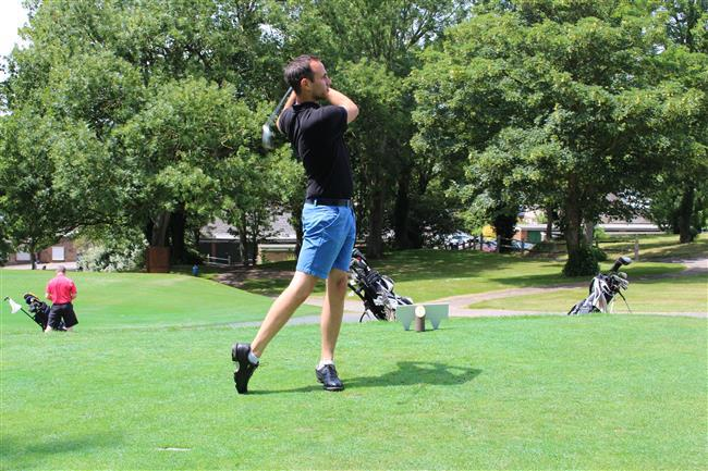 Image of golfer taking a swing as part of the Guild Cares 27th Annual Golf Challenge