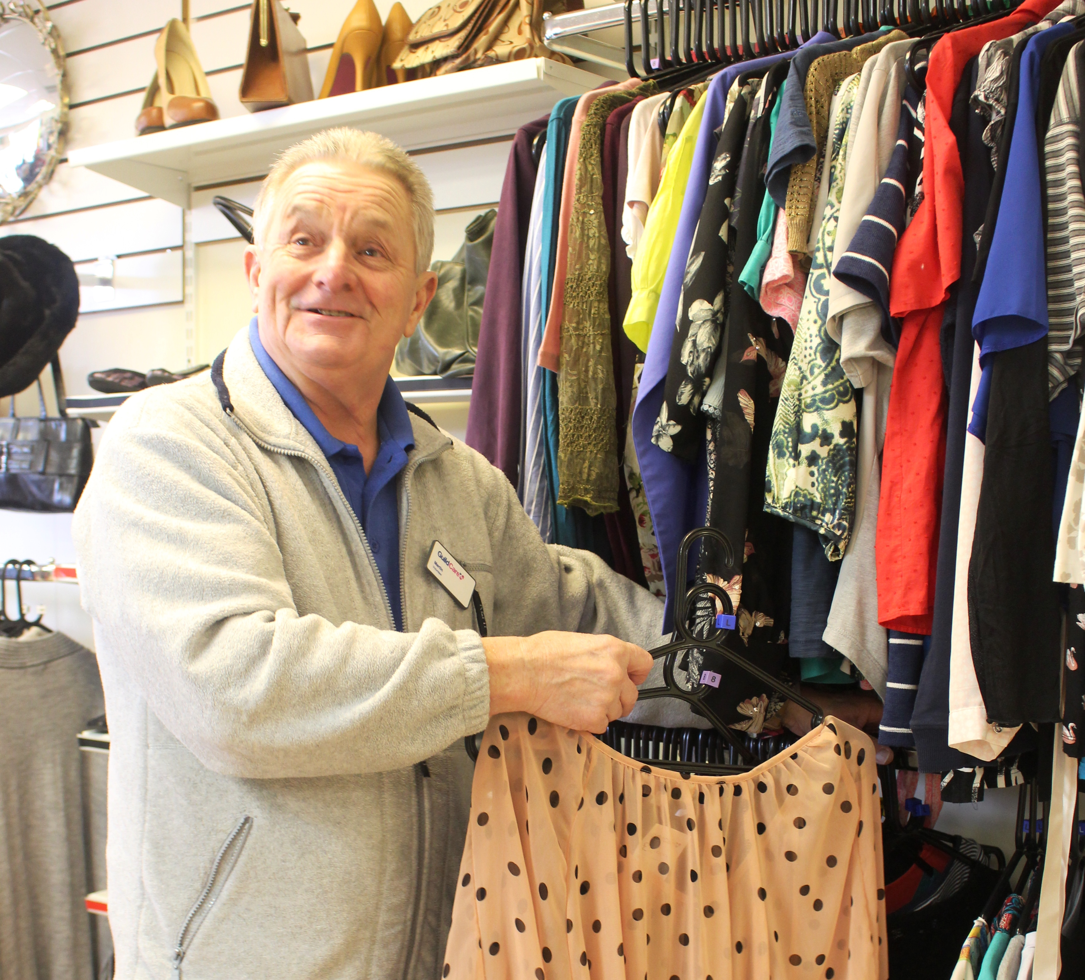 A volunteer hanging clothes in the Goring Road charity shop