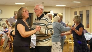 Day centre users dance in Methold House