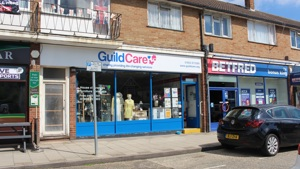 Guild Care shop front. Beneath the logo it says Local charity providing life-changing services. Next door to BETFRED.
