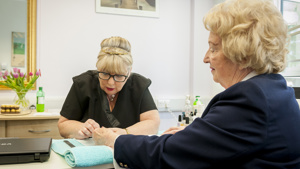 A Caer Gwent resident have her nails done in the salon by a beautician