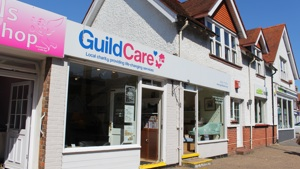 Guild Care shop front. Beneath the logo it says Local charity providing life-changing services