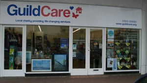 Guild Care shop front. Beneath logo it says local charity providing life-changing services