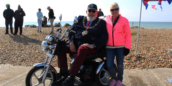 Cllr Paul Baker and his Wife Sandra posing in front of the sea on the Worthing seafront