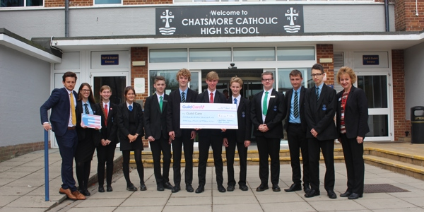 Students and staff from Chatsmore Catholic High School holding a cheque