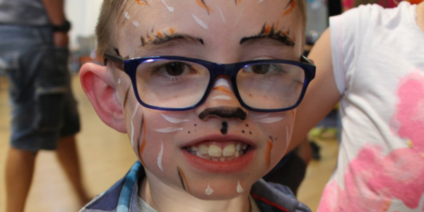 Child at the Ashdown Centre with tiger face paint