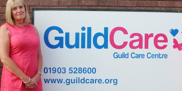 Chair of Guild Care Antonia Hopkins standing outside Guild Cares Methold House