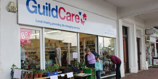 The front of a Guild Care charity shop