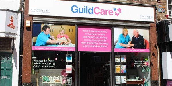Guild Care shop front. Also has signage which says Our Ashdown Centre for children with additional needs, GuildCare is a charity in the heart of the community providing care to local people with dementia, learning & physical disabilities, Care servic