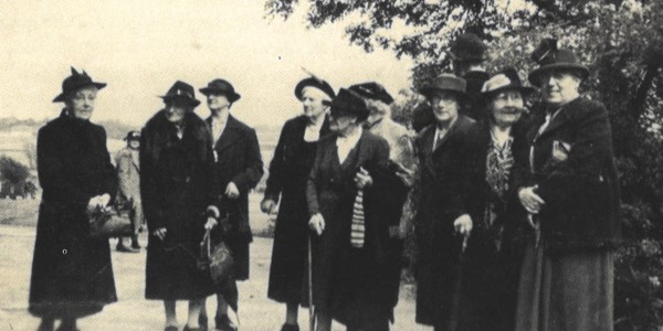 Black and white photo of a group of women in a country lane