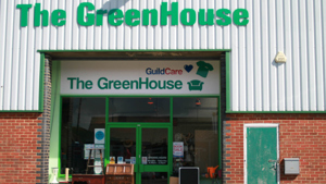 Shop front with the words The GreenHouse and Guild Care above it