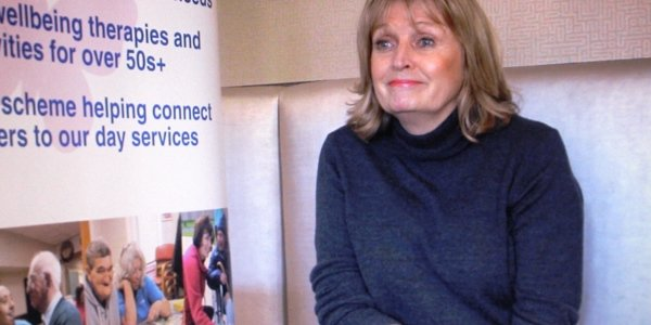 A guild Care trustee (Antonia Hopkins) sat down with a Guild Care banner by her side