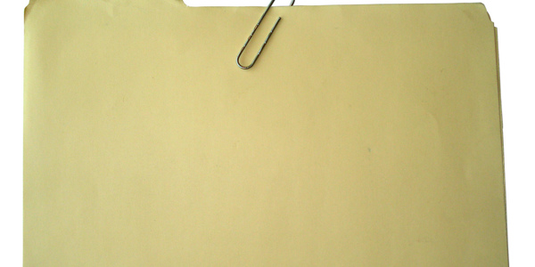 A cardboard folder with a paperclip